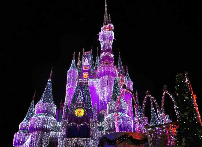 pink white and purple light up disneyland castle